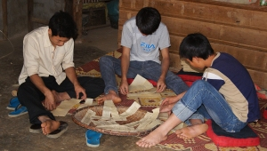 Mien men participating in animistic rituals.